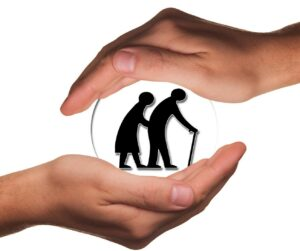 Two Seniors, surrounded by protective hands